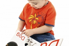 Addorable Toddler Boy Reading Alphabet Book