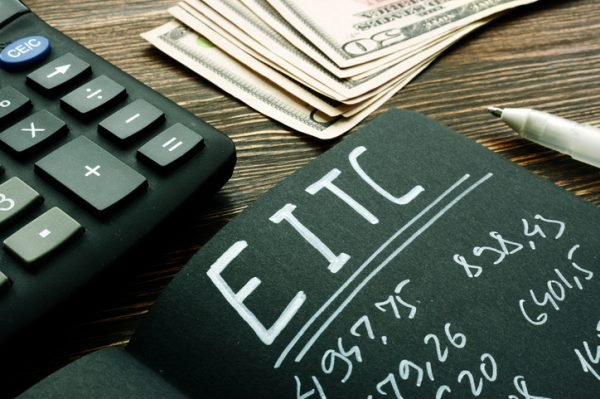 EITC Earned income tax credit calculations on the black page.