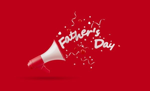 Father's Day written over red megaphone on red background. Horizontal composition with copy space. Father's Day concept.